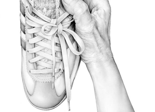 Hand Holding Adidas Trainer